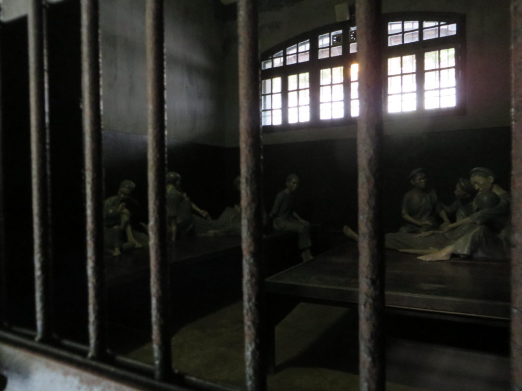 A group cell for female inmates at Hoa Lo Prison.