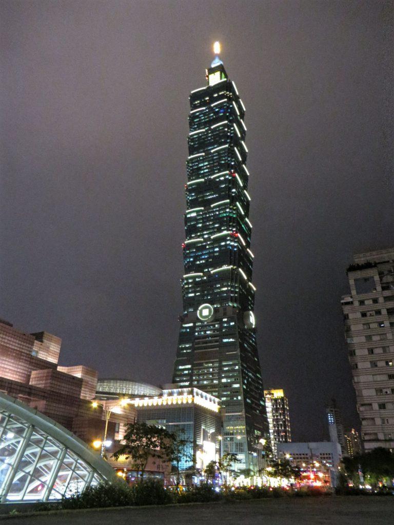Taipei 101 lit up at night.
