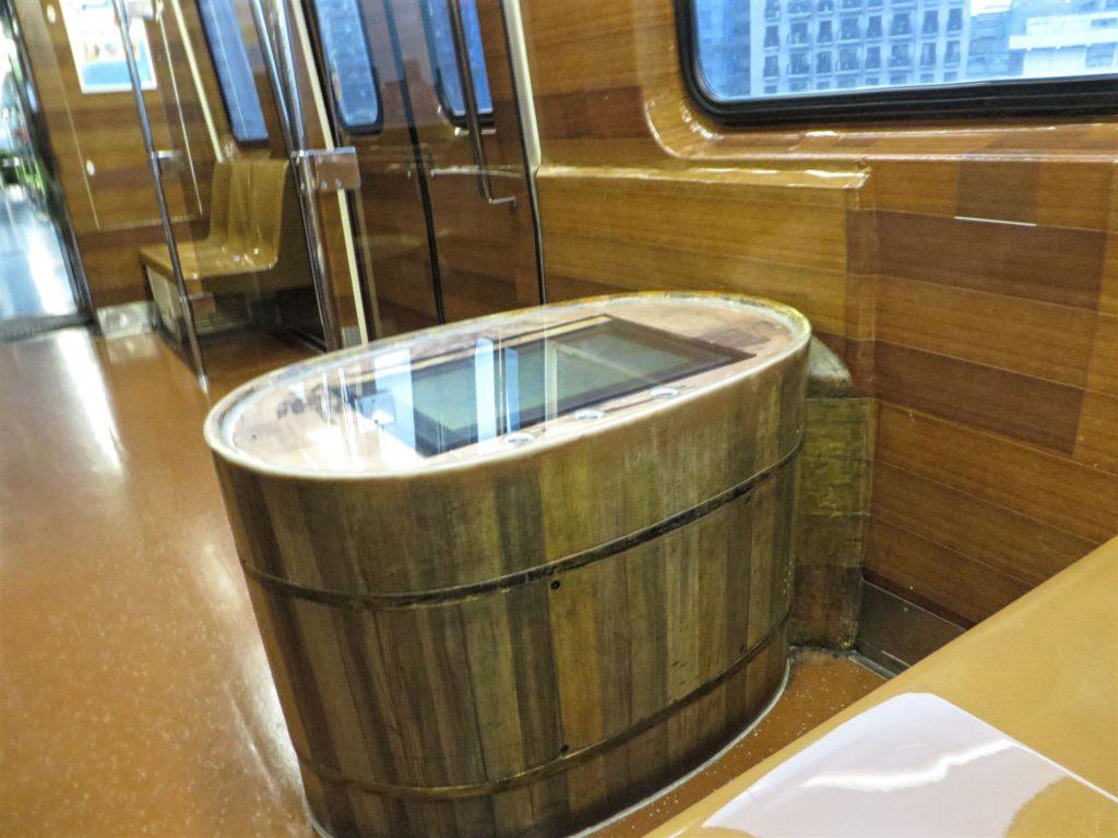 Train car featuring a soaking tub information kiosk.