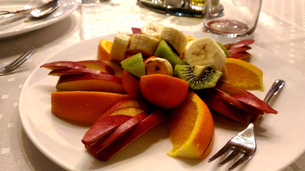 An unexpected fruit plate appears.